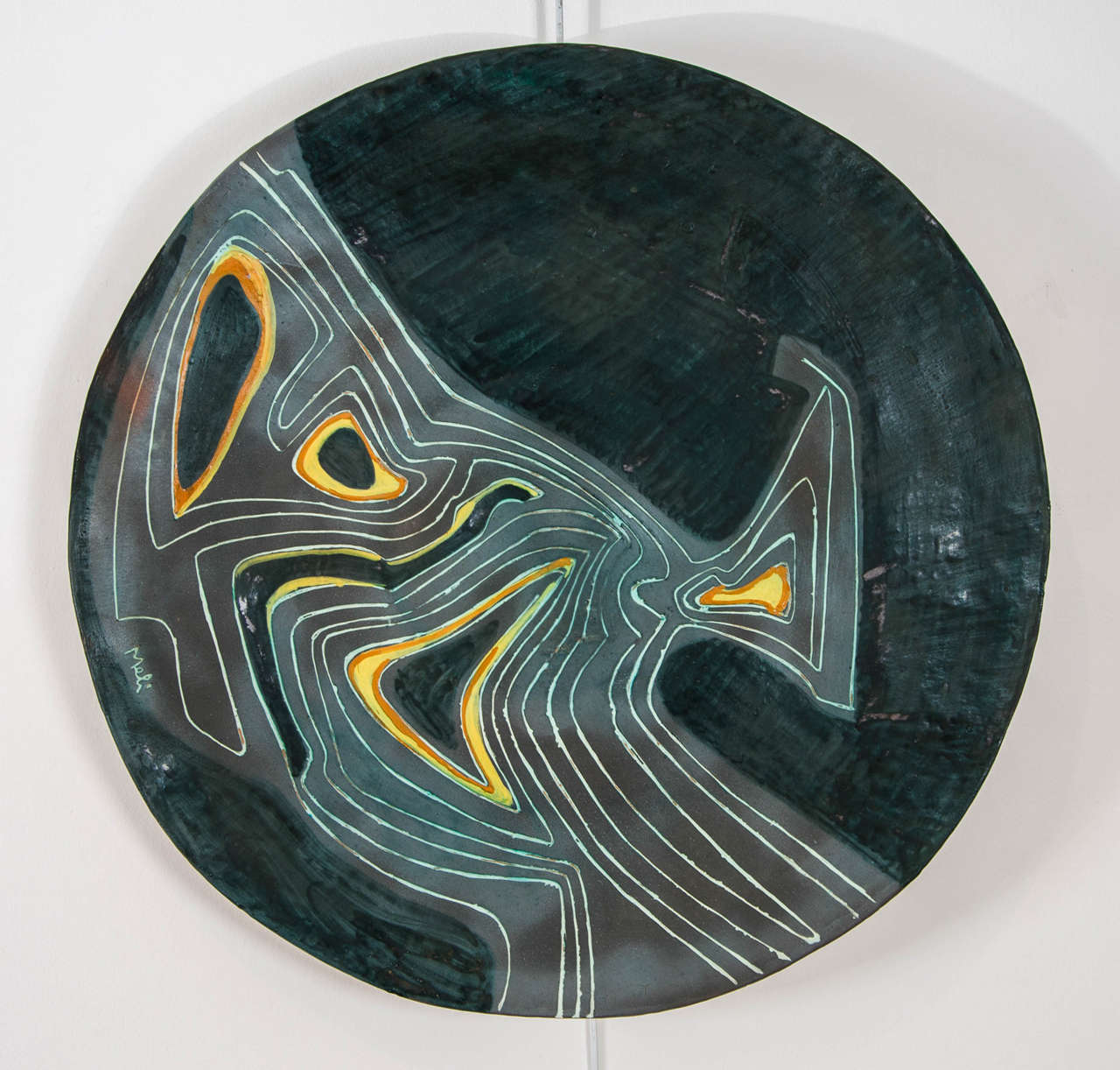 Large and impressive charger with abstract linear pattern on a green ground Signed 'Meli'.