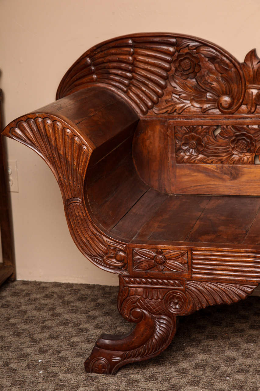 Indonesian teak settee with detailed carvings from jakarta 19th century in good condition for sale
