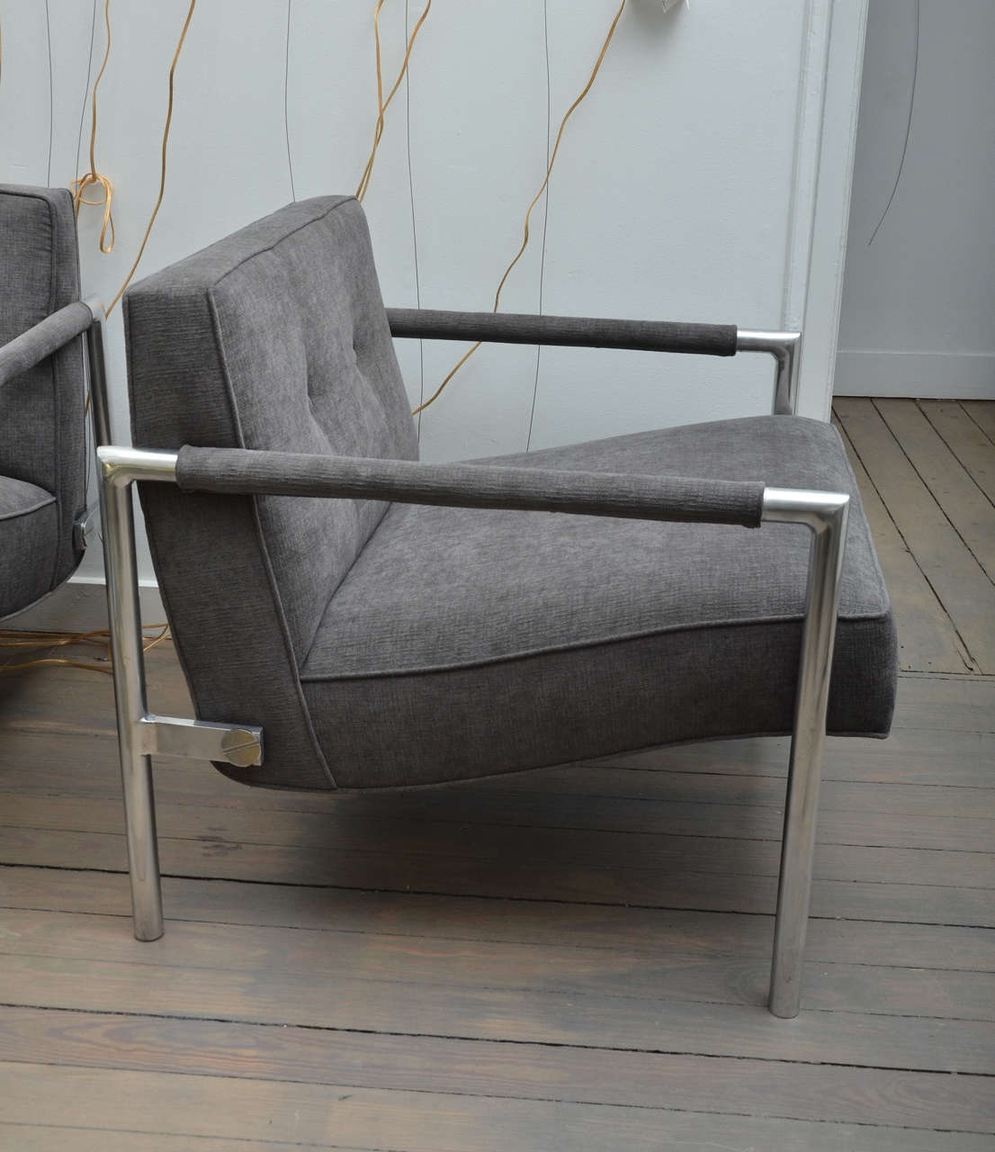 Mid century modern pair of aluminum frame upholstered chairs in the style of harvey probber