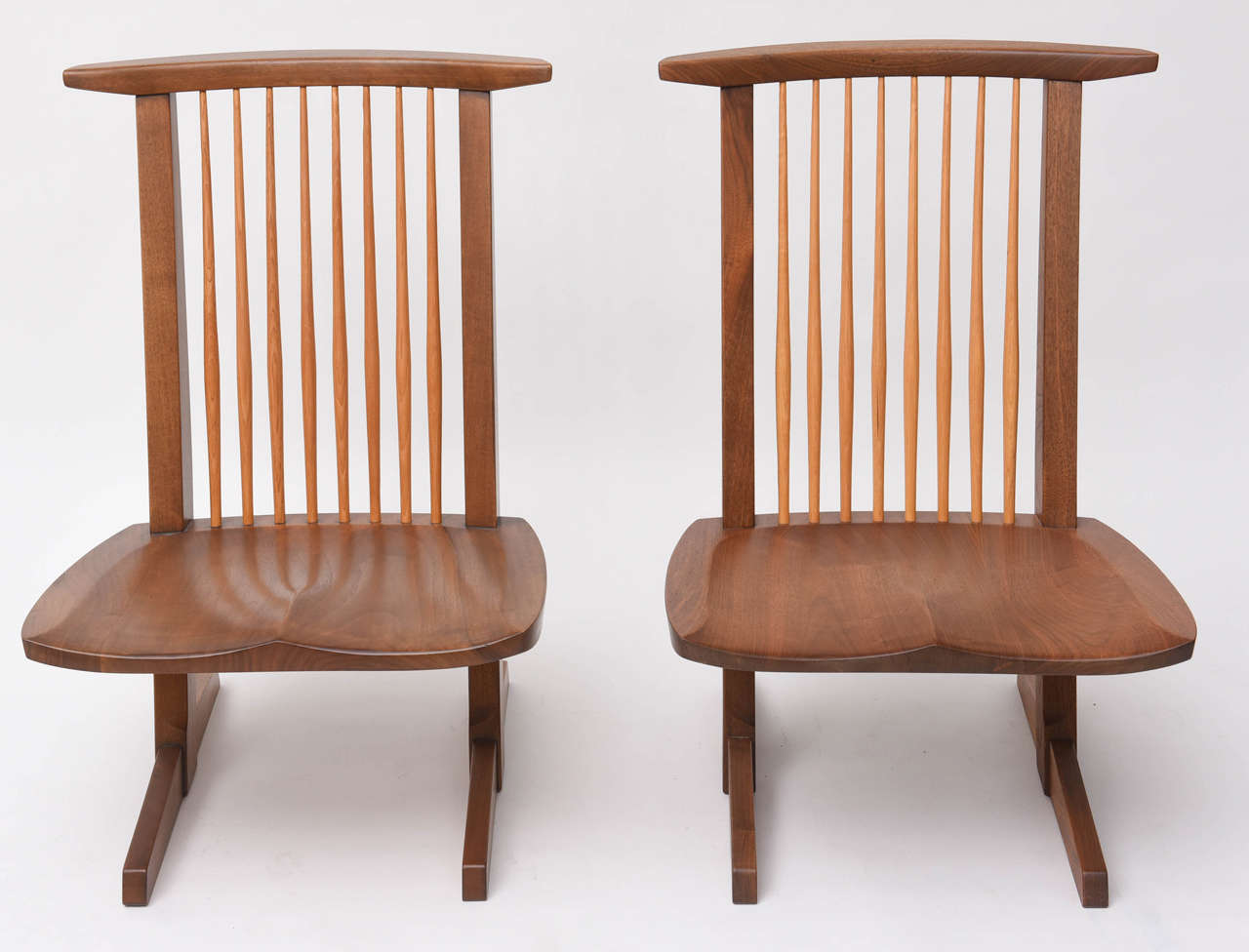 George Nakashima Conoid low chairs. A rarely seen design from the studio.
