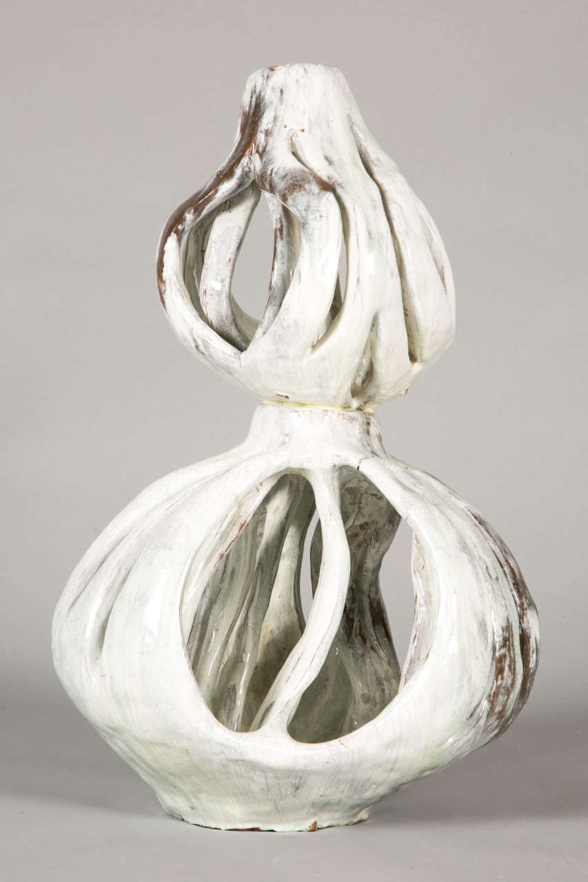 Incredible enameled stoneware openwork sculpture, by Alice Colonieu (1924-2010), milky white and light green dripping decoration on a darker ground. Signed.   Alice Colonieu (1924–2010) was a very original artist, working without cast for her