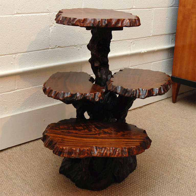 Here is a great Japanese root table with three tiered shelves.<br />
