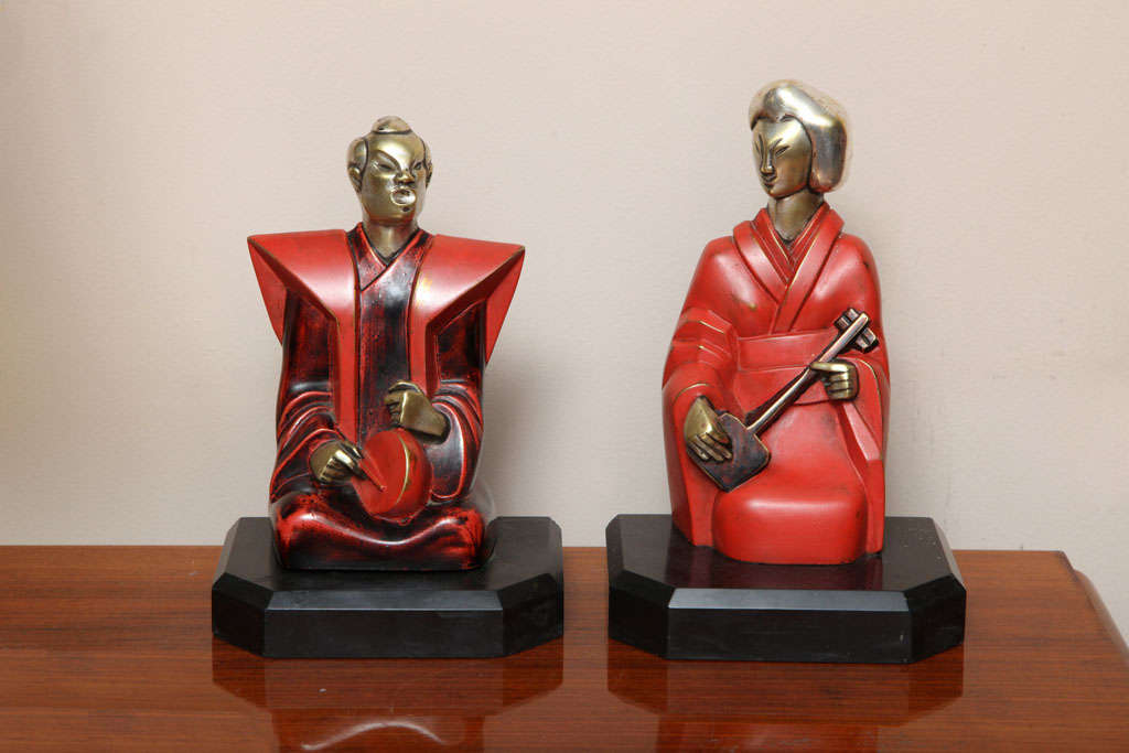 Pierre Ernest Bouret. Silvered and lacquered bronze bookends, from circa 1928, signed and numbered.   French sculptor Pierre Ernest Bouret (1897-1972) was a member of the Salon des Tuileries, member of the Salon d'Automne, a professor at the