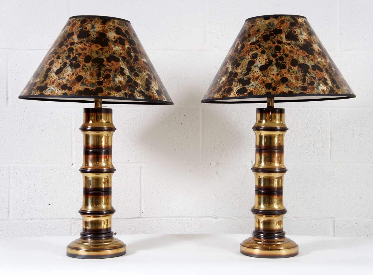 Here is a pair of brass lamps with a bamboo motif.