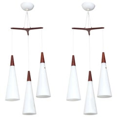 Pair Holmegaard Glasvaerk Triple Hanging Pendants in White Glass & Teak, 1950s