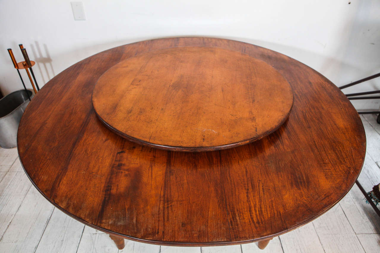 this distinct rustic round dining table with built in lazy susan is no