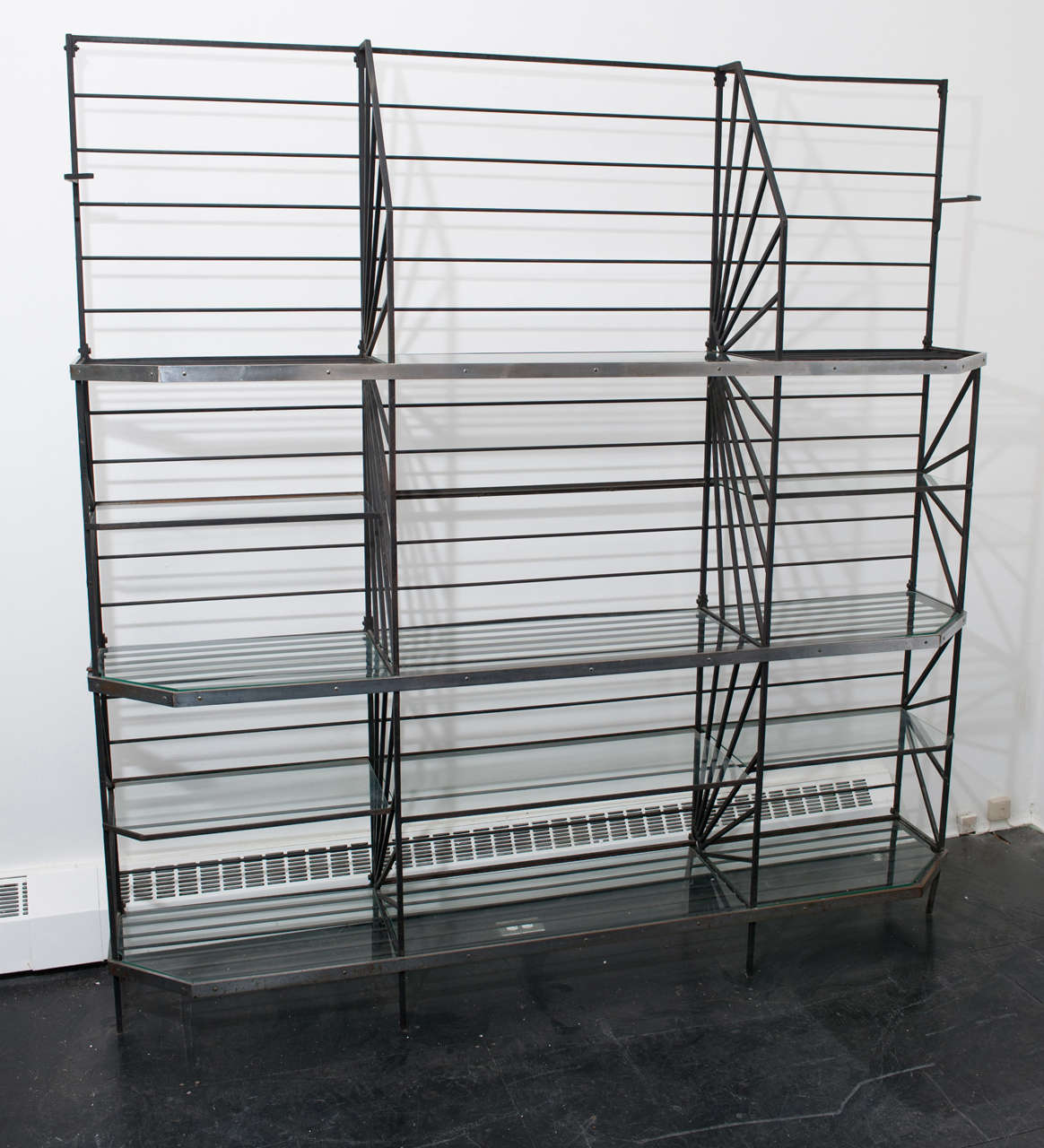 This is a stunning bakers/ display rack from the Art Deco period with fitted glass shelves and chrome metal banding. A sculptural and geometric beauty that combines form and function.