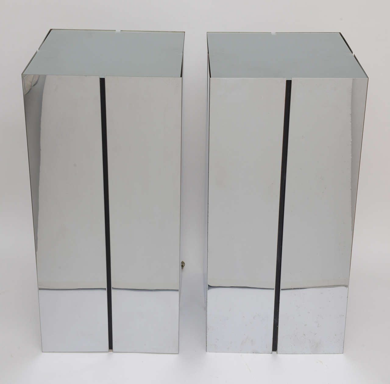 Pair of chromed steel illuminated pedestals with frosted glass tops designed by Neal Small for George Kovacs.  Note: One of the glass tops has a small chip on the underside, which is right above one of the interior braces. See image #10  Note: