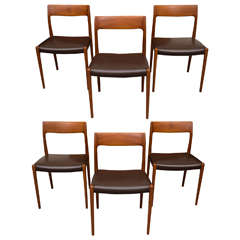 Six Teak JL Moller Chairs with Brown Leather Seats, One a Captain's Chair