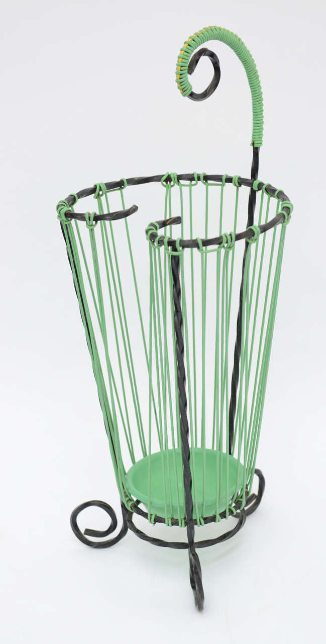 This French vintage umbrella stand trwisted cast iron and light green