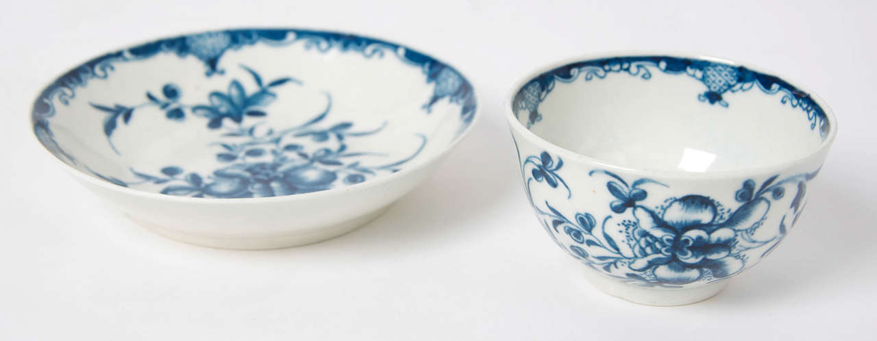 This is a good early, First period (Dr. Wall), Worcester porcelain tea bowl and saucer, decorated in cobalt blue with the 'Mansfield' pattern.  There is a Worcester hand-painted open crescent to the base of both pieces.  Excellent condition, no