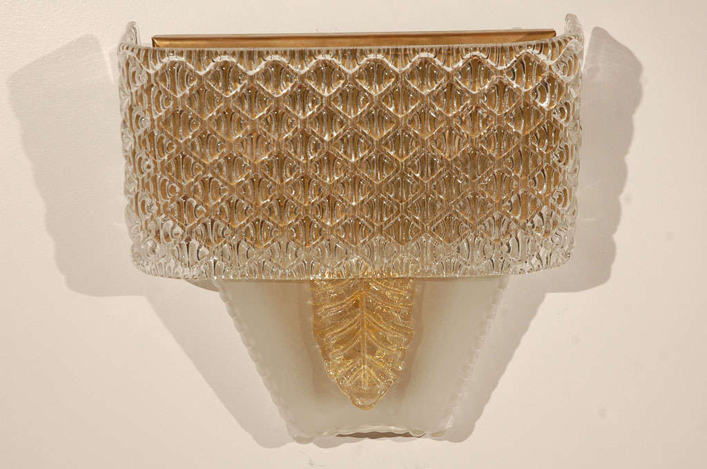 Pair of Murano sconces with basketweave detailing and leaf element. Two pairs available. Sold by the pair.