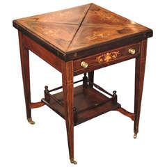 "Antique English inlaid rosewood ""envelope"" game table."