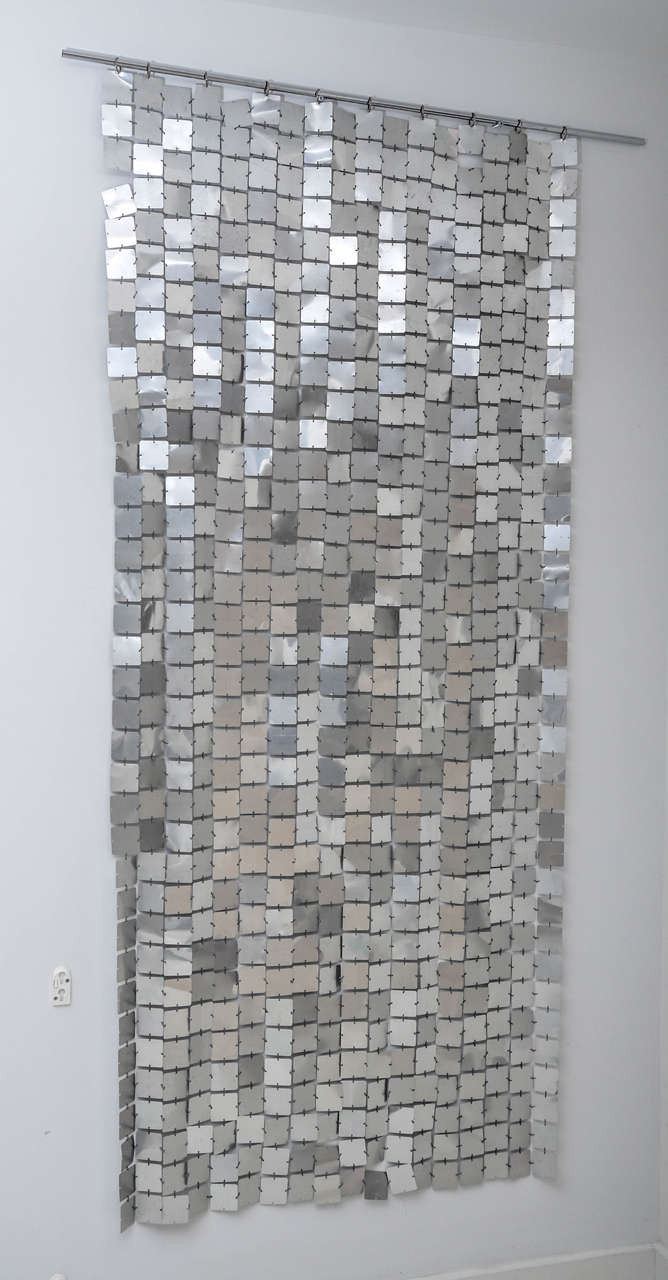 The iconic 1970s space curtain designed by Paco Rabanne for Software/ Baumann AG of Switzerland. Comprised of linked plasticized aluminum discs. Excellent original condition.
