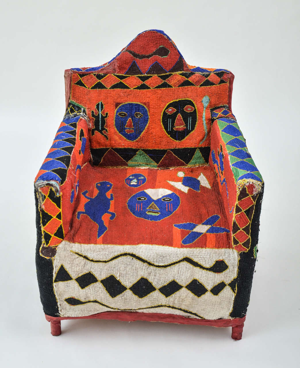 Colorful and intricately hand-beaded chair with iconic tribal, geometric and animal motifs.