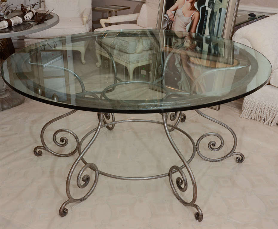 Round glass top dining table with attractive wrought iron for Glass coffee table wrought iron legs