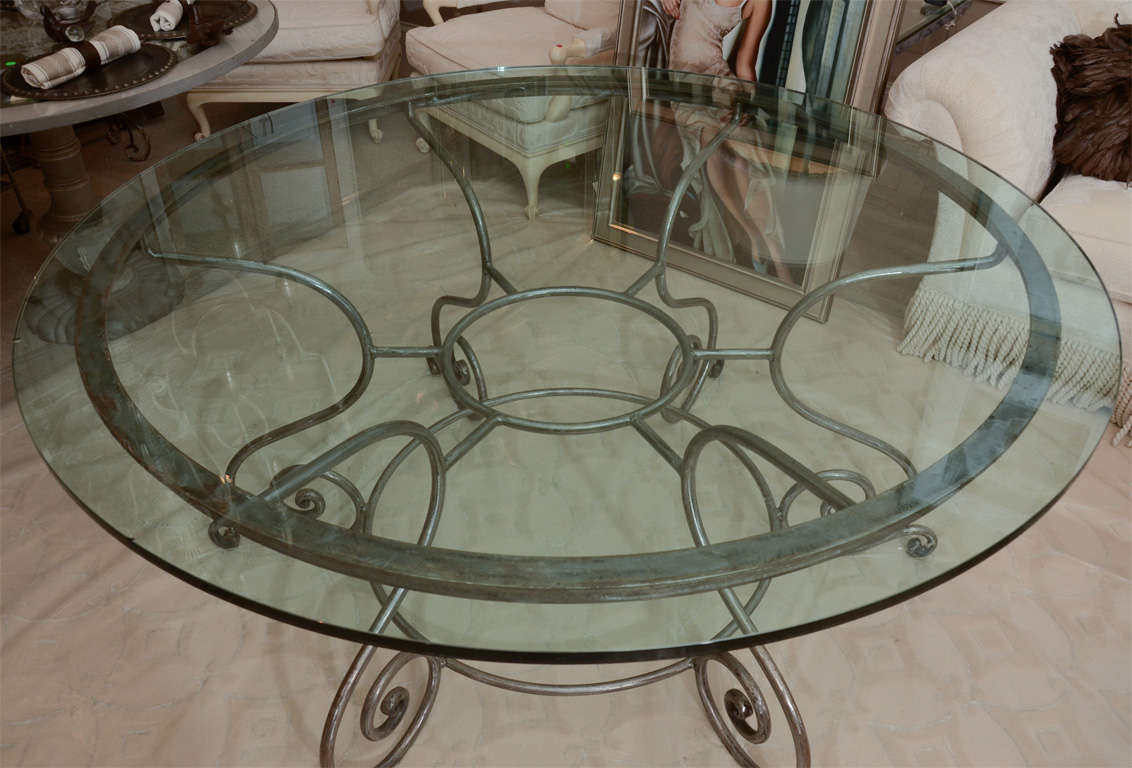 Round Glass Top Dining Table with Attractive Wrought Iron Base at