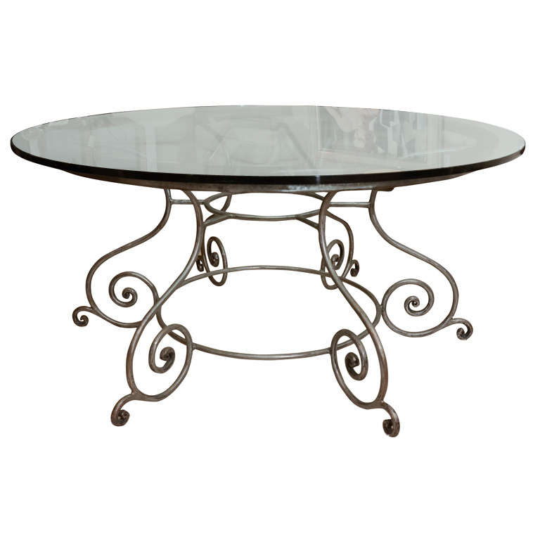 Round Glass Top Dining Table With Attractive Wrought Iron Base 1