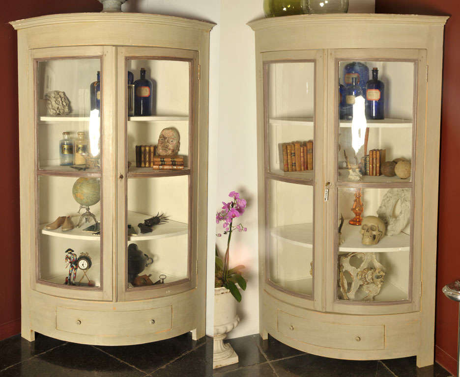A Pair Of Painted, Half Round Shaped Corner Cupboards, Each With 4 Shelves  And