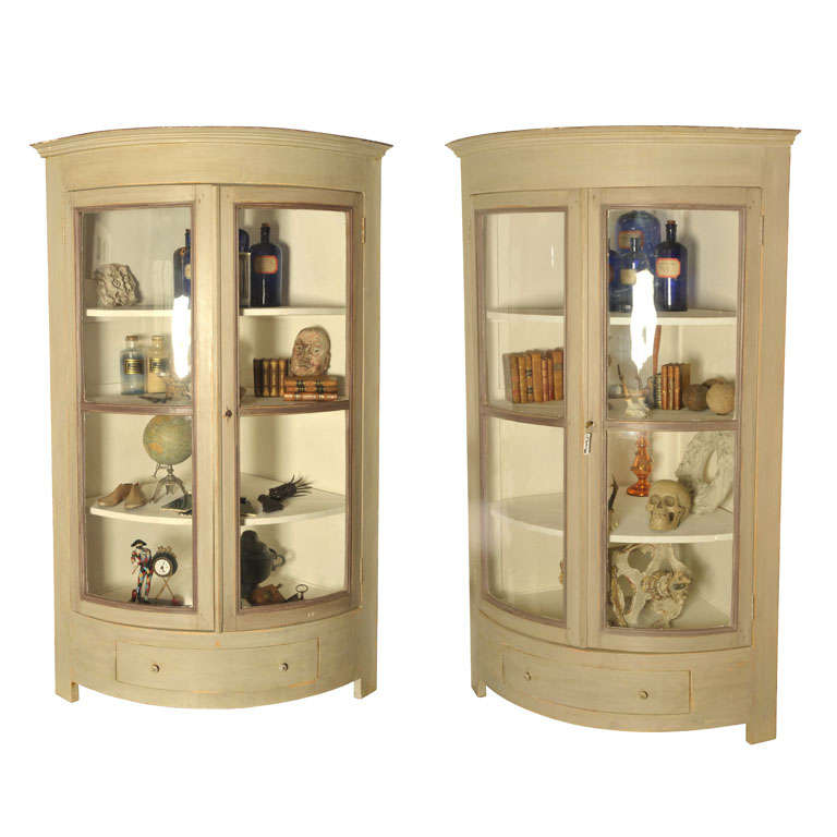 A Pair Of Half Round Shaped Corner Cupboards For
