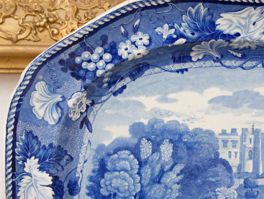 This blue and white platter is by Enoch Wood & Sons and shows a view of Brancepeth Castle west of Durham, once the home of the Nevilles. It has a blue printed pattern mark and an unreadable impressed mark on back.