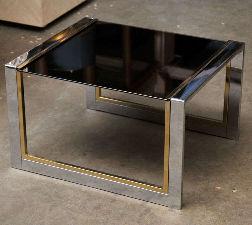 Very elegant small chrome, brass and glass side table with smoked glass top.