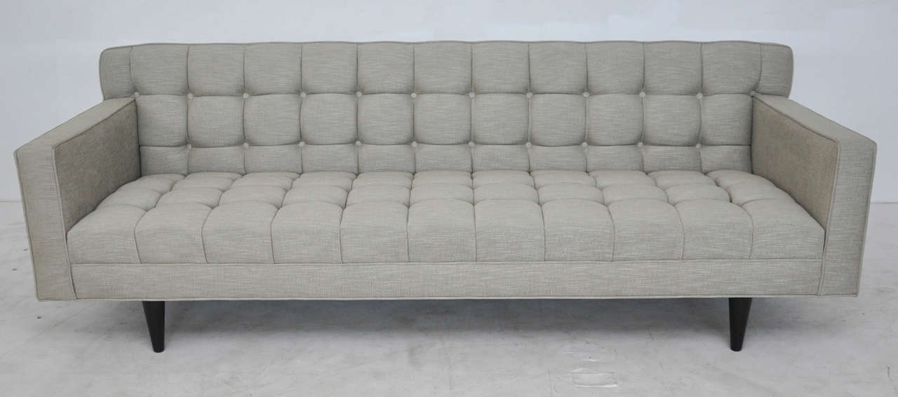 Tufted Dunbar sofa model 5136 by Edward Wormley, circa 1950s. Original dark ebonized mahogany legs. Newly upholstered.