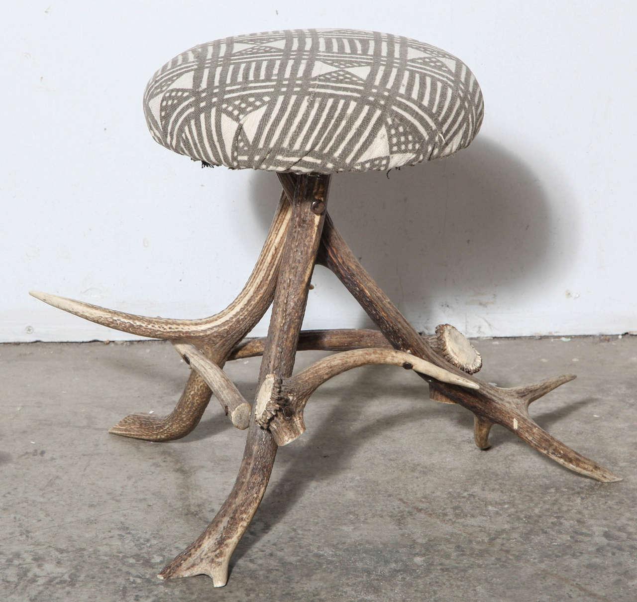 Antler stool; upholstered in African handblocked cotton.