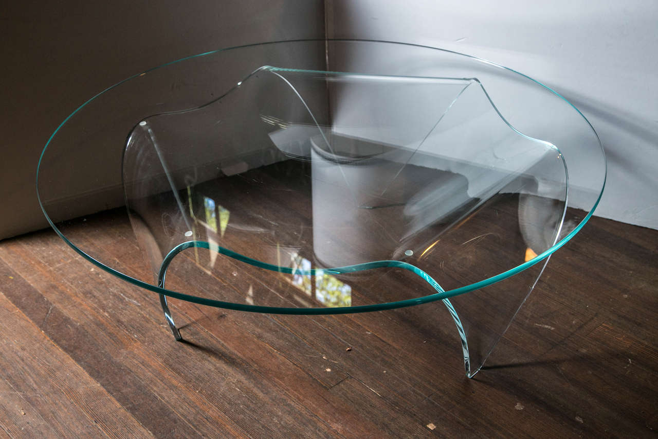 Tripod glass base and round top glass coffee table.