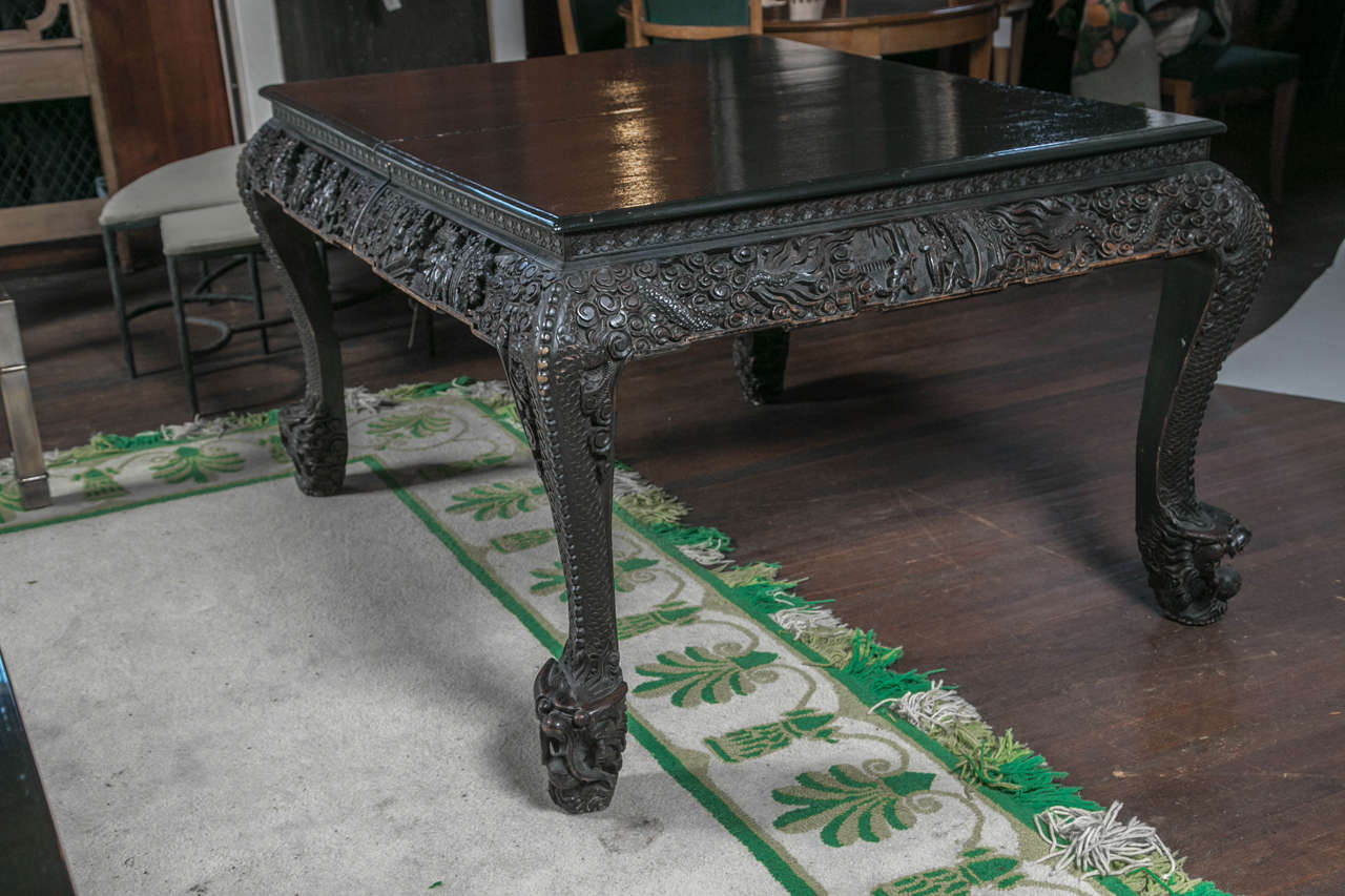 """High drama! Carved wood 1920s Asian table with two 18"""" wide leaves. Tabletop is 42"""" x 53""""."""