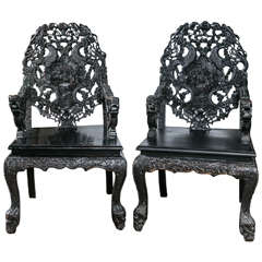 Pair of Carved Wood Asian Armchairs