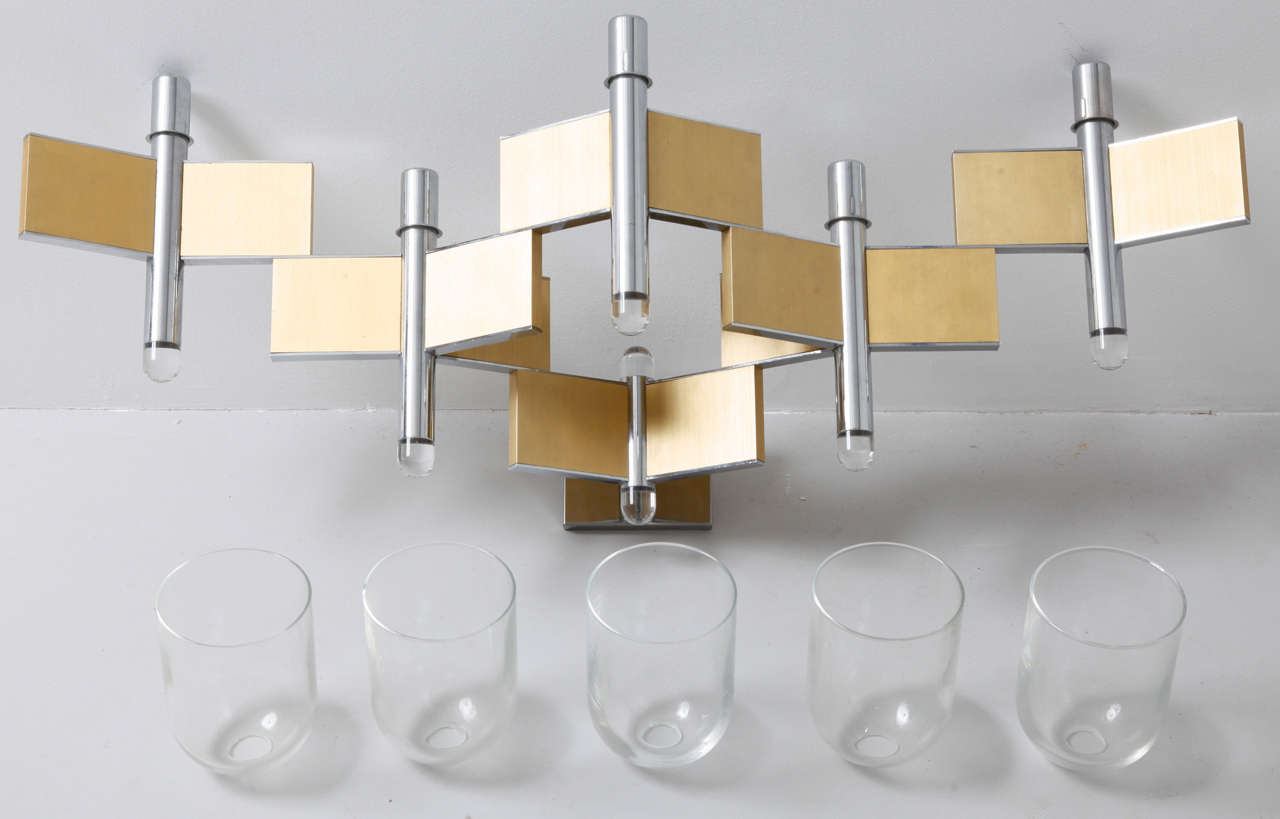 Large wallamp designed by Geatano Sciolari Italy 1970s. brass,chrome and clear glass.