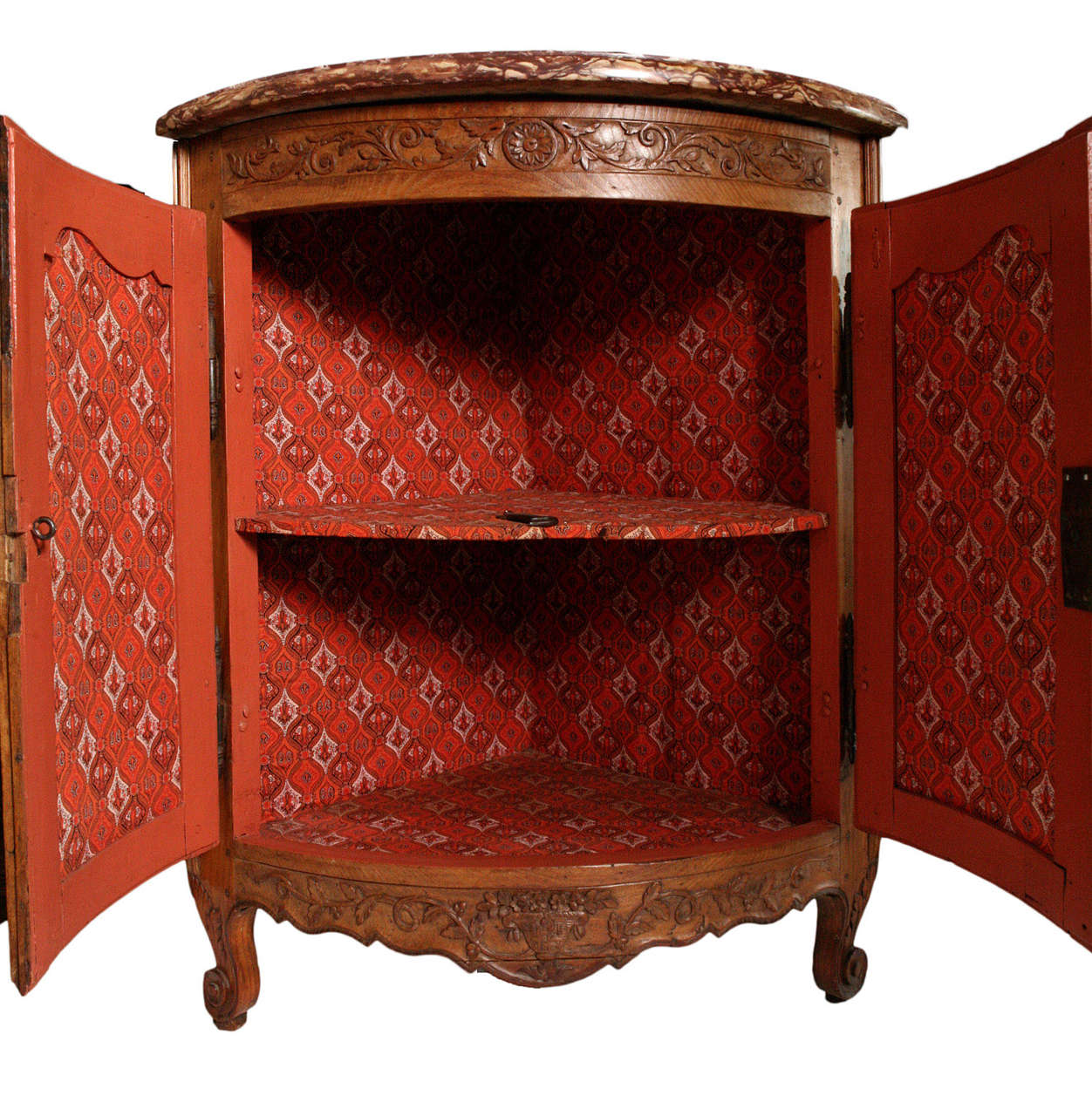 Bowfront corner cabinet with original rouge marble top.  Carved frieze, apron and feet.  Painted interior with fabric.  Lock and key.