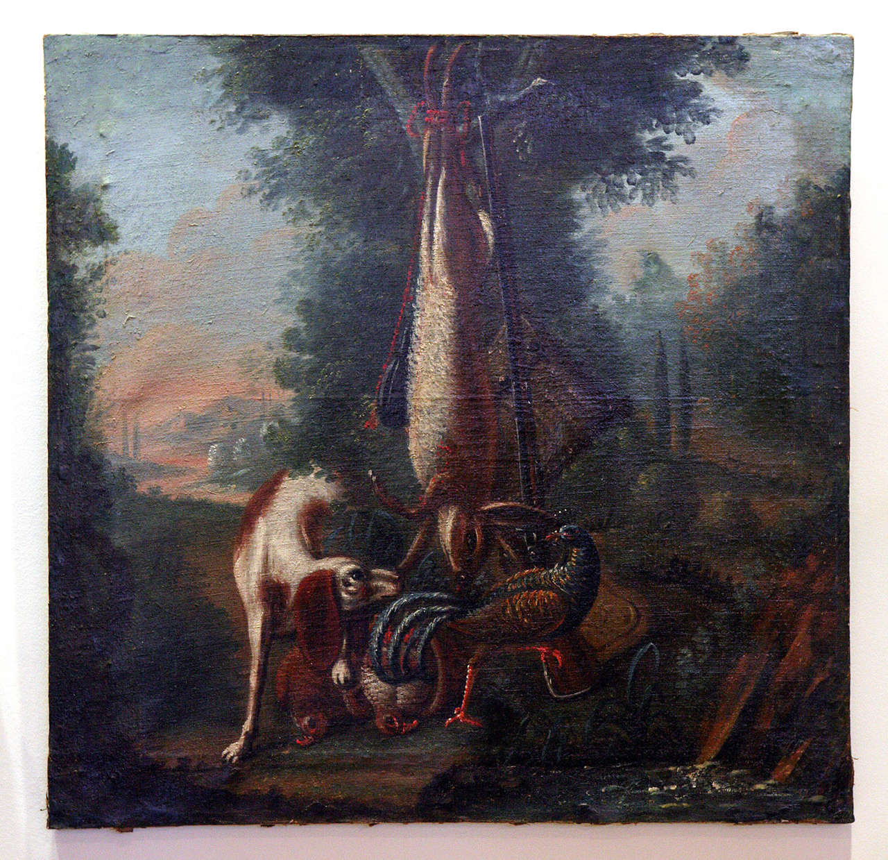 Spaniel oil painting set in French or Italian landscape.  Dog with trophies of the hunt.  Canvas stretched on wood frame.  Some restoration.