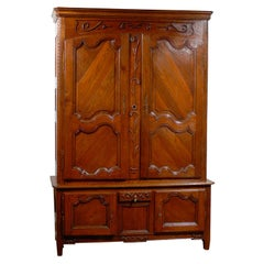 French Oak Buffet à Deux-Corps with Floral Motifs from Eastern France, 1820s