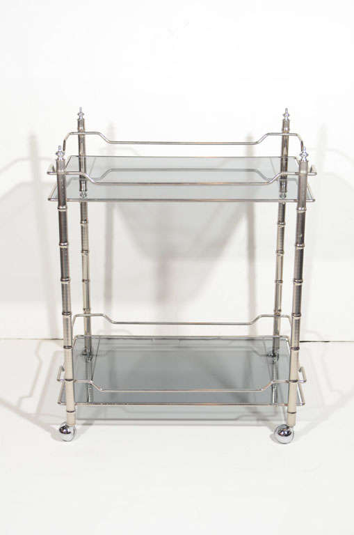 Hollywood Regency bar cart with bamboo motif in chrome. Two-tier design with tinted smoked grey glass tops.