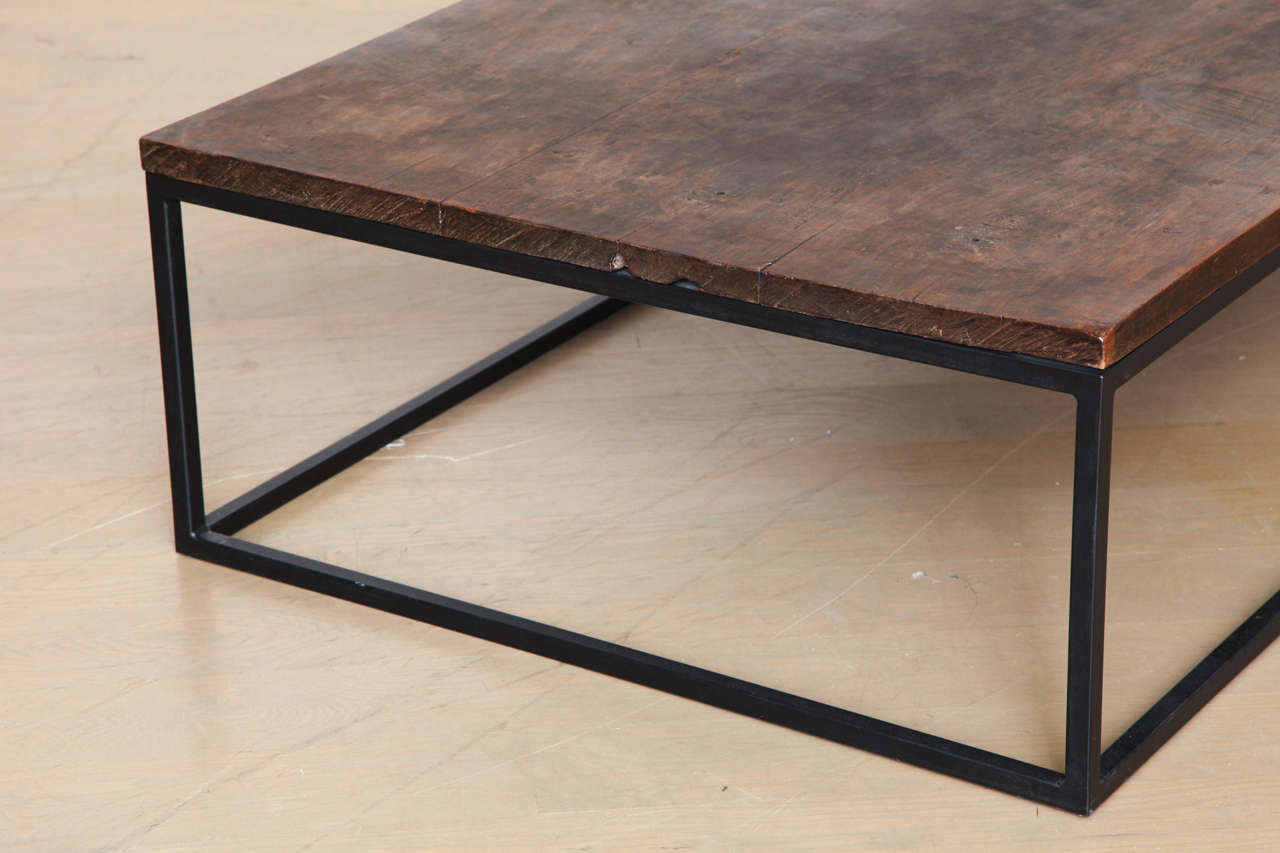 rich dark teak wood coffee table with contemporary iron base
