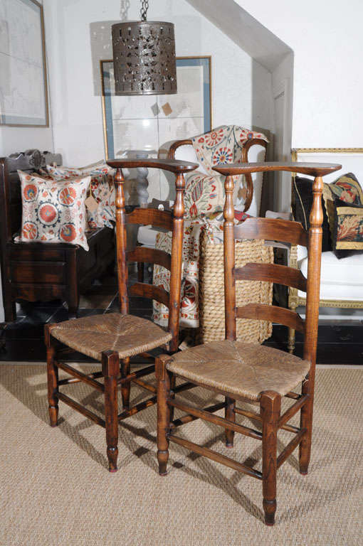 These petite, ladder back chairs were meant for children's prayer. The quatrefoil attachment on the backs housed the bible. These chairs are so multifunctional. They can be set in a recessed area and embellished with books or a potted plant set atop