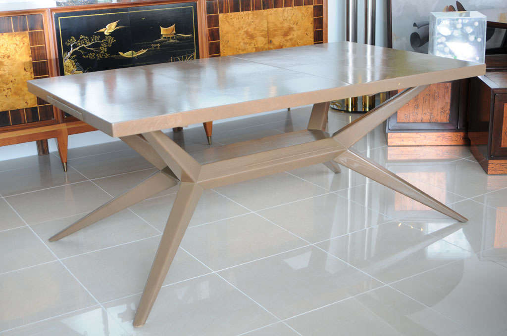 A Rectangular Limed Oak Dining Table W 2 Leaves By