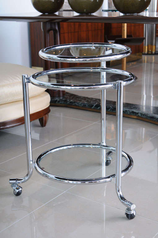 Single chrome rolling swivel side table attributed to
