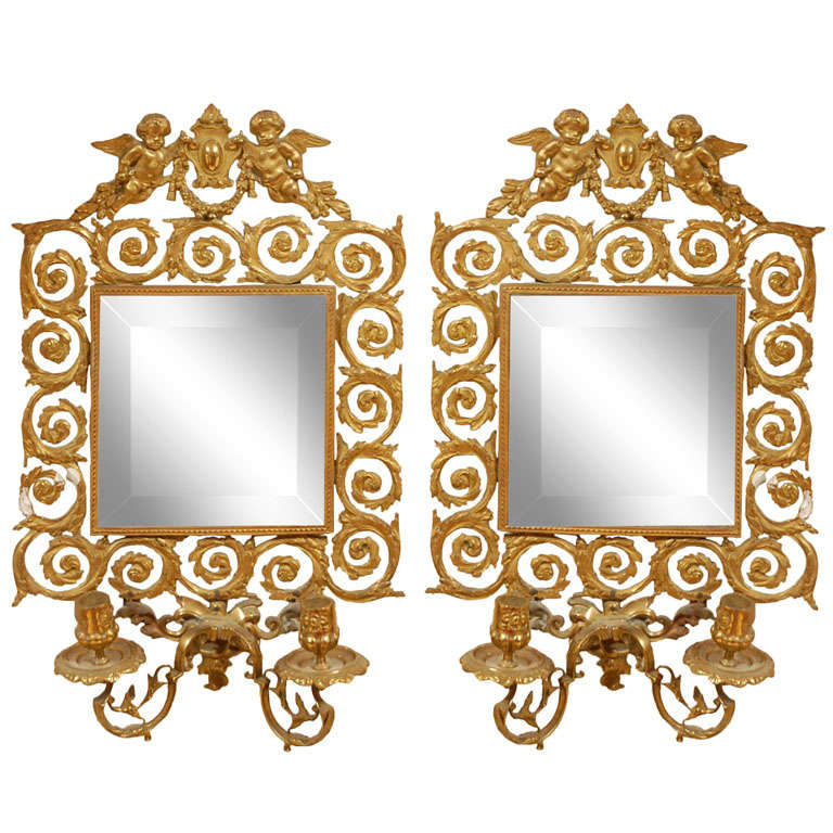 Pair of French Bronze Mirrors With Candleholders.