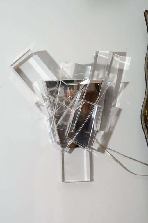 Pair of acrylic block sconces with mirrored stainless steel frames.