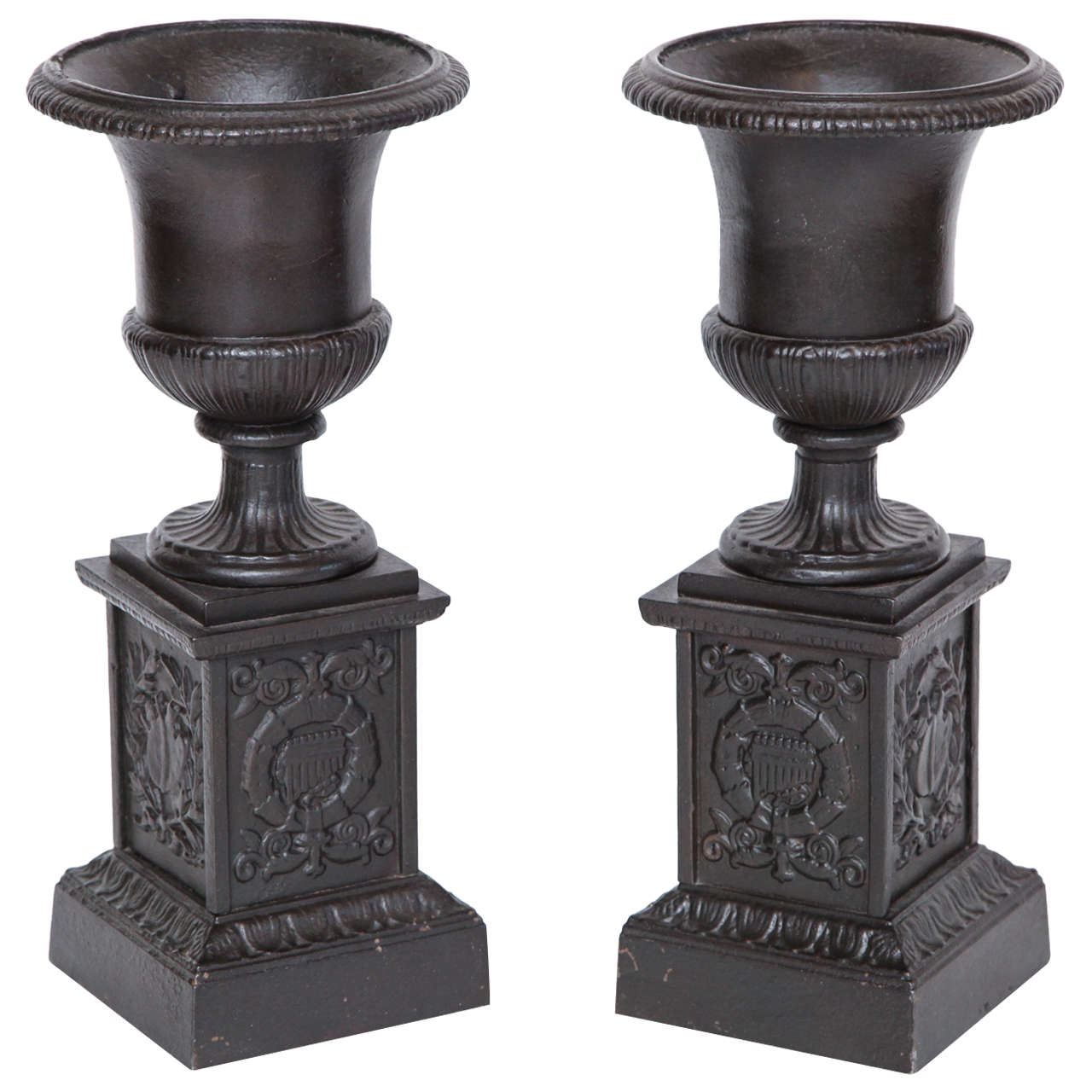 Pair of 19th Century Iron Neo-Classical Urns For Sale