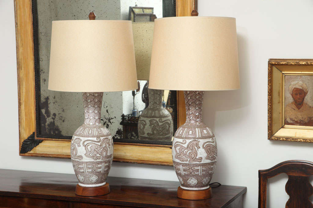 Pair of Italian ceramic white and brown glazed lamps with etched horse decorations.