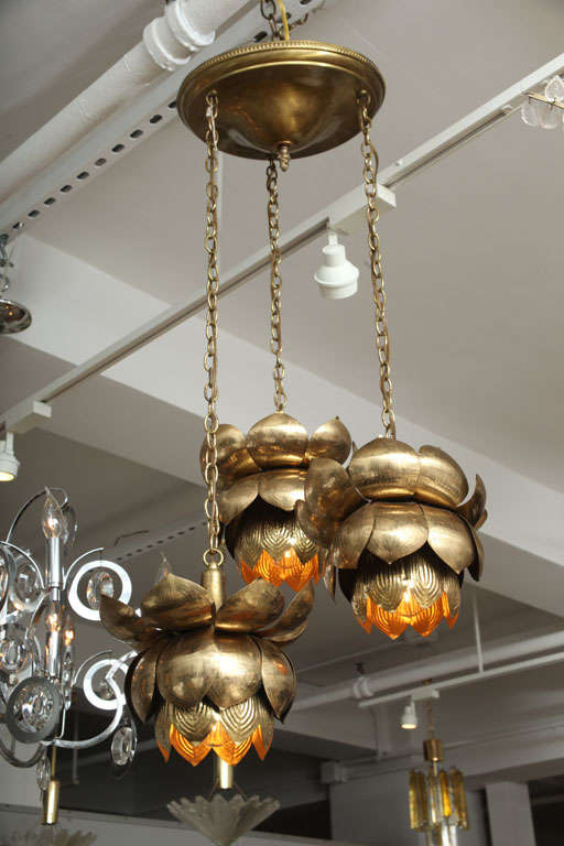A trio of lotus blossom lights hung at graduating lengths. They look great hung in a grouping, but can also be hung as separate pendants.