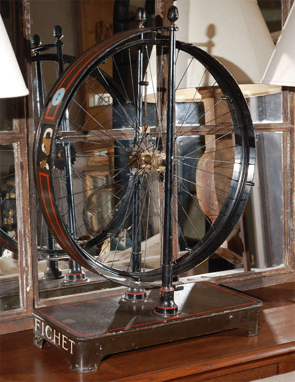 1880s French Painted Metal Spoked Wheel on Stand In Good Condition For Sale In Los Angeles, CA