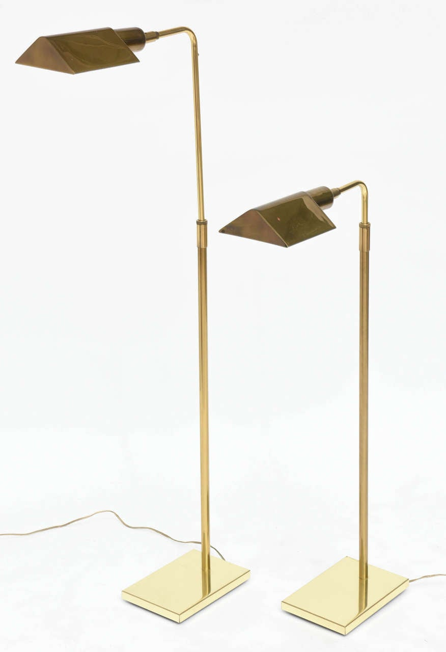 The triangular adjustable shade with an adjustable pole on a rectangular weighted base.