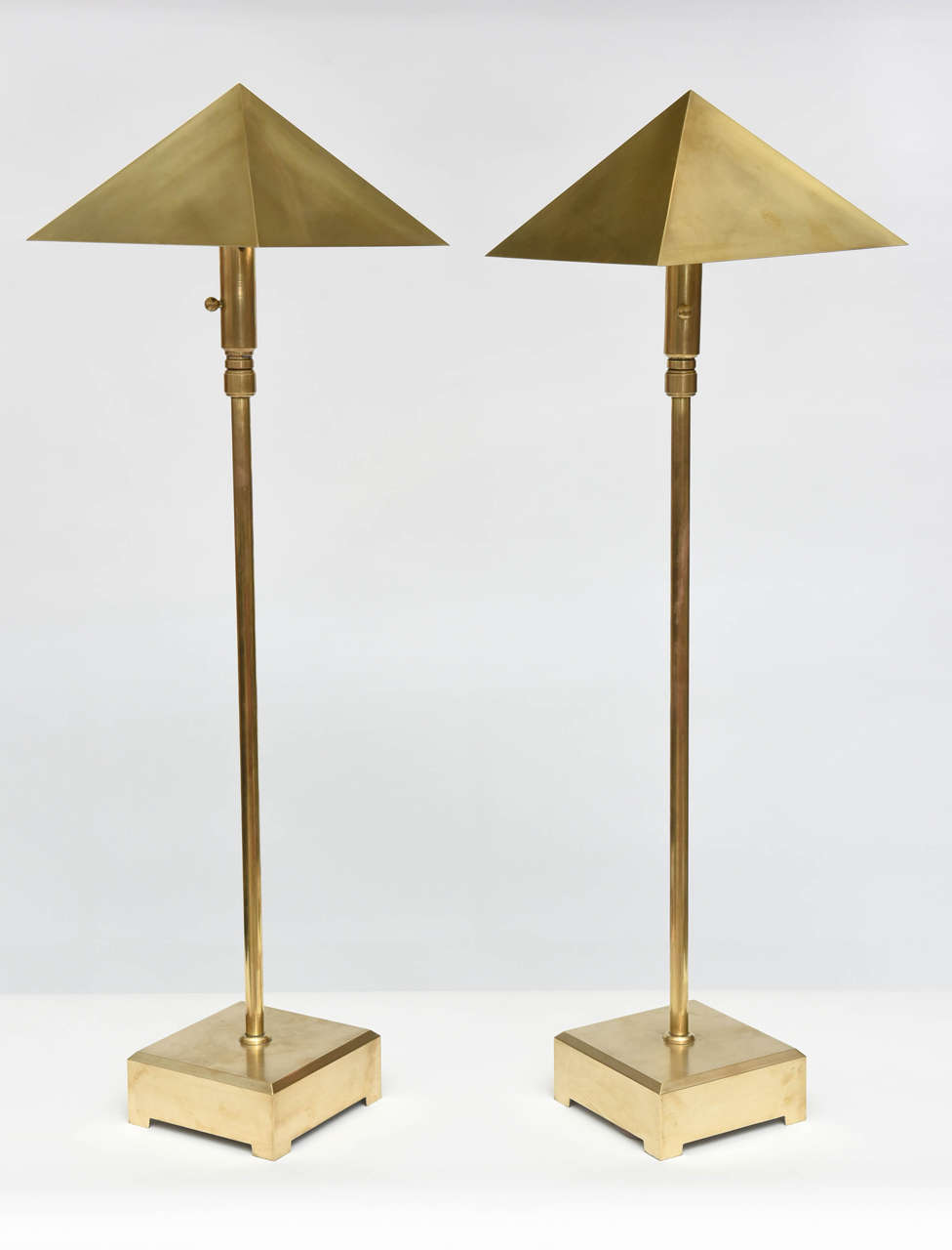 The pyramidal shade above an adjustable pole to extend or shorten the overall length, on a square plinth with bracket feet 40.5 without extension, extents to 64