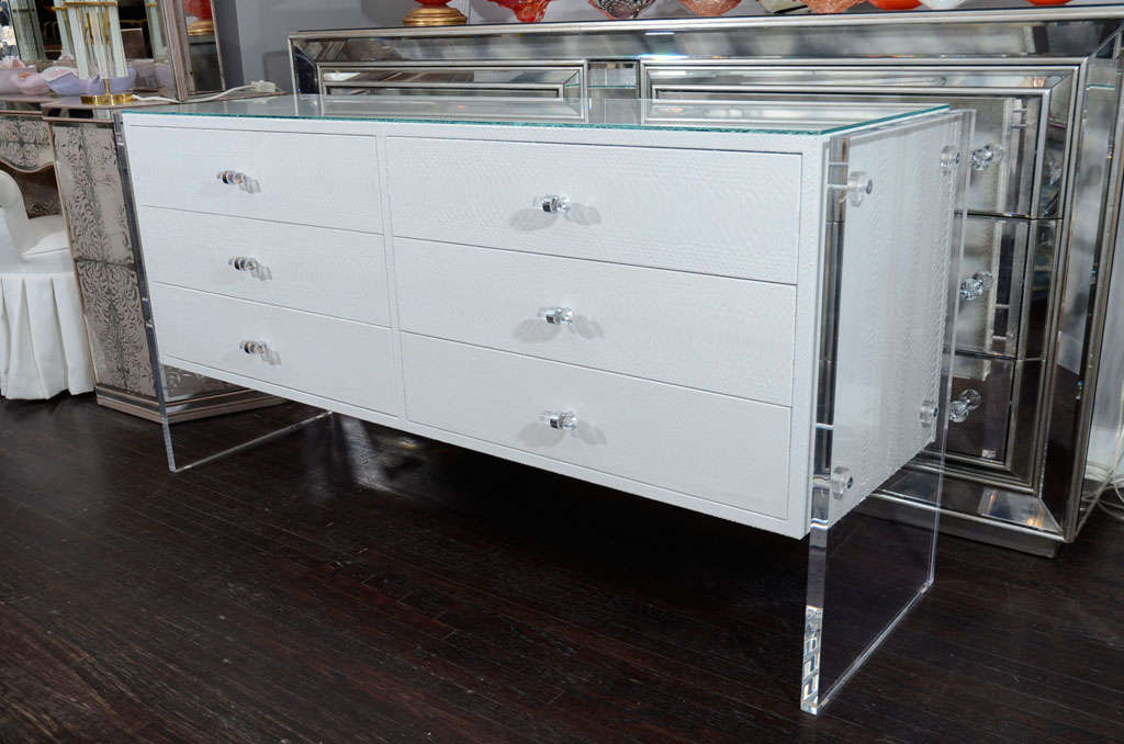 Six-drawer genuine python dresser with Lucite side panels.