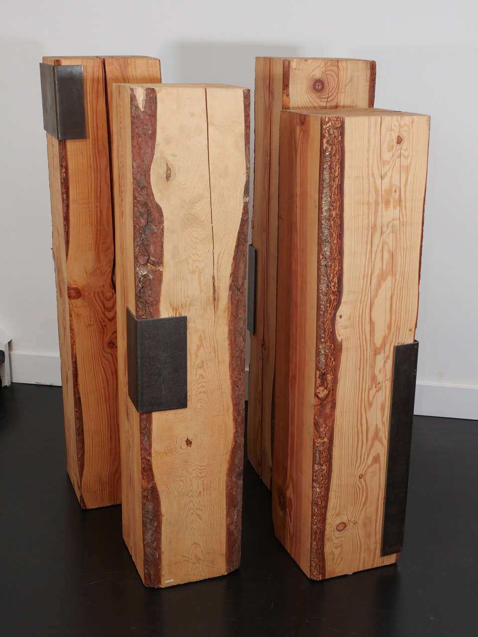Sculptural pedestals by design duo Garouste and Bonetti, produced by Cat Berro. Raw pine with iron details. The pedestals were used to display silver pieces by Franco-Russian object designer Goudji in Orleans. Very strong presence and art pieces on